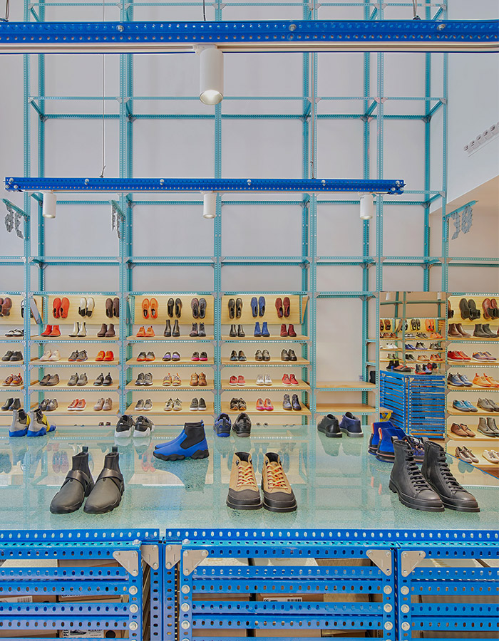 Oficina Penadés takes warehouse to a whole neon level. The newest CAMPER store in Málaga is a definition of leather footwear meets good-design.
