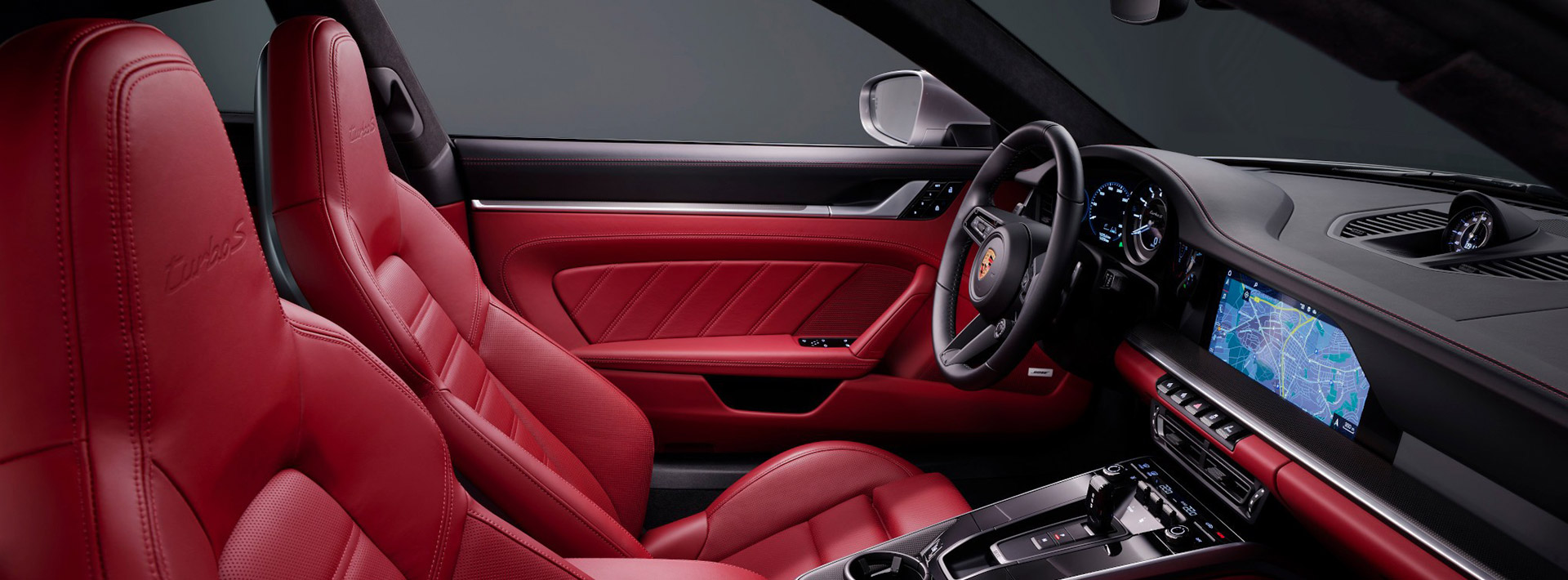 2021 Porsche 911 Turbo S Coupe & Cabriolet revealed with 640 HP — inside, full leather and carbon fiber trim with light silver accents.