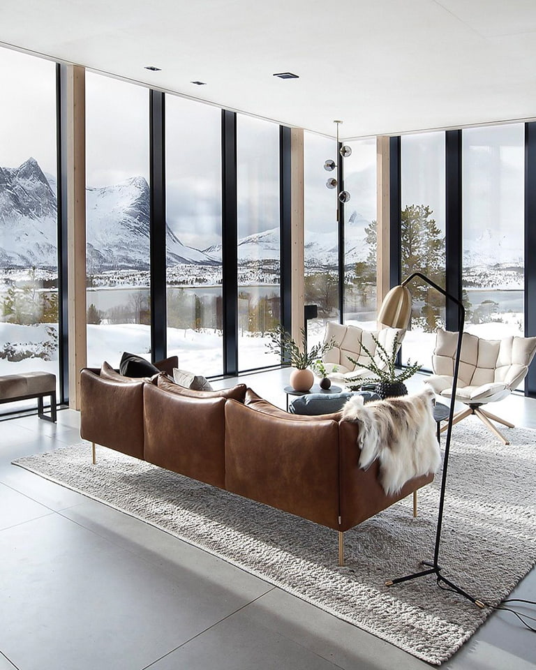 Meet the ultimate leather furniture dream retreat: the Efjord glass cabin in Norway.