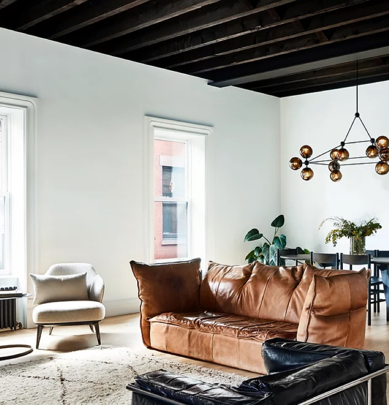 The Clinton Hill residence is where Arnold Studio blends classic leather furniture & a modern exterior.