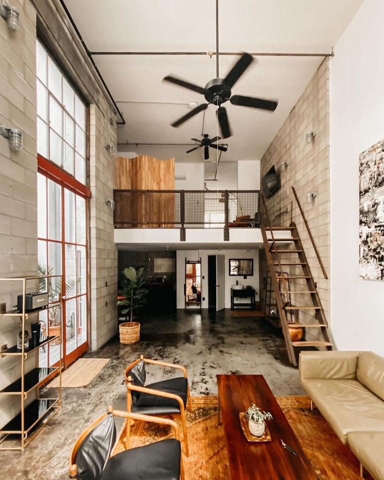 Loads of natural light & leather key-pieces in a loft that will make you want to visit California.
