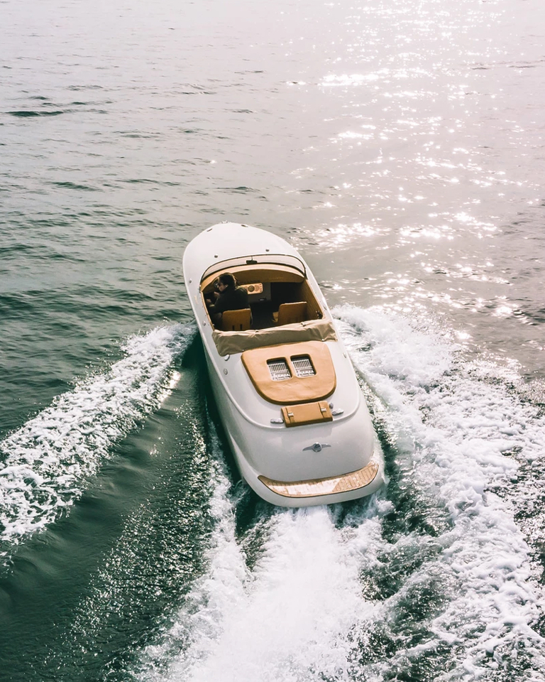 With smooth lines and custom leather interiors, this boat is a contemporary fusion of a classic Porsche convertible and 1930s runabout boats.