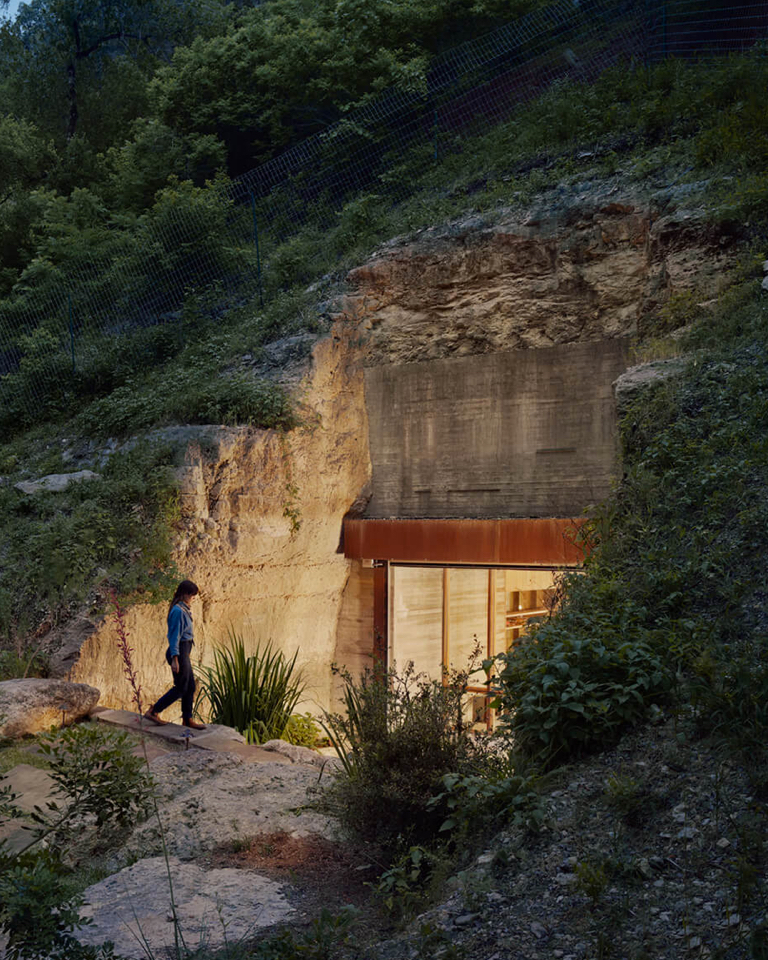 The architecture office used nature to its advantage and built this hidden wine cellar in a cave.