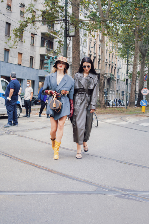 Milan Fashion Week  - Dolce Gabbana fashion show -  Yellow Leather Boots, LV leather bag and leather trench coat.