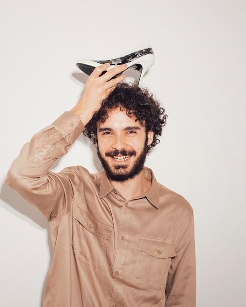 METCHA - Matteo Maiorano Interview - Matteo Maiorano Portrait with leather heel over his head