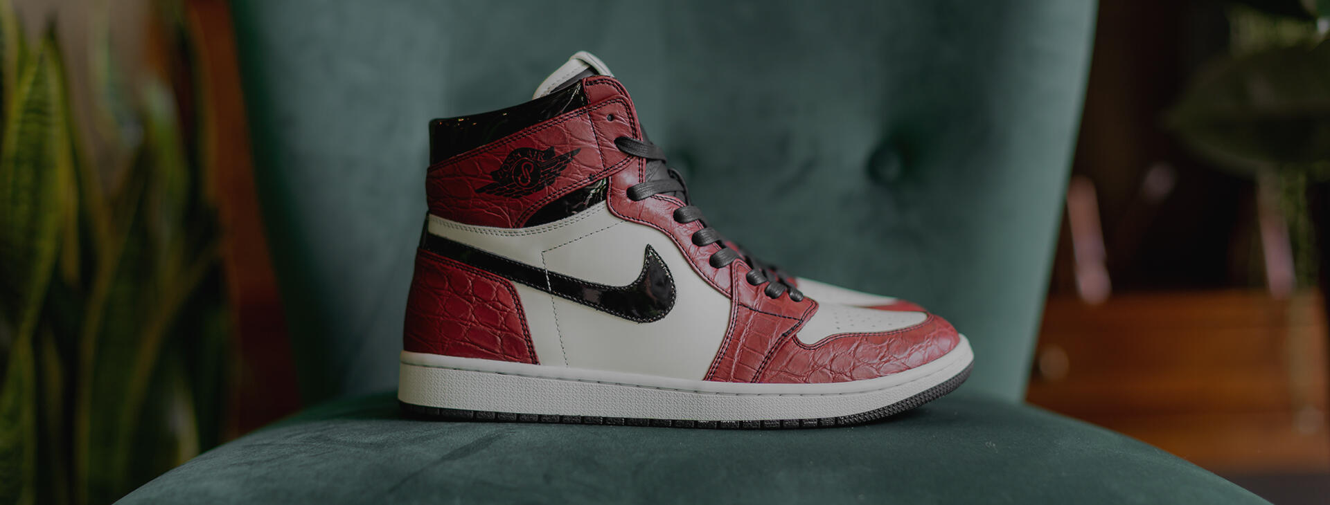 The brands teamed up to create a custom AJ and a handbag in red Nappa leather to raffle for the Fashion Scholarship Fund.