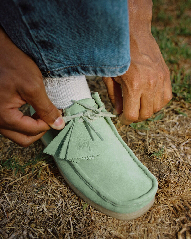 METCHA - Clarks' suede craftsmanship - a guy tying his suede shoes' laces.